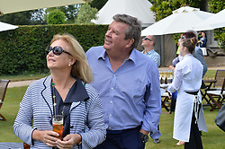 MR & MRS JOHANN RUPERT he is Chief Executive of Richemont at the Cartier hosted Style et Lux at The Goodwood Festival of Speed at Goodwood House, West Sussex on 29th June 2014.