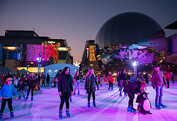 © Licensed to London News Pictures. 29/11/2014.  Bristol, UK. A temporary winter ice rink has been set up in Bristol's Millennium Square by the Planetarium in the harbourside in the run up to Christmas.  Photo credit : Simon Chapman/LNP