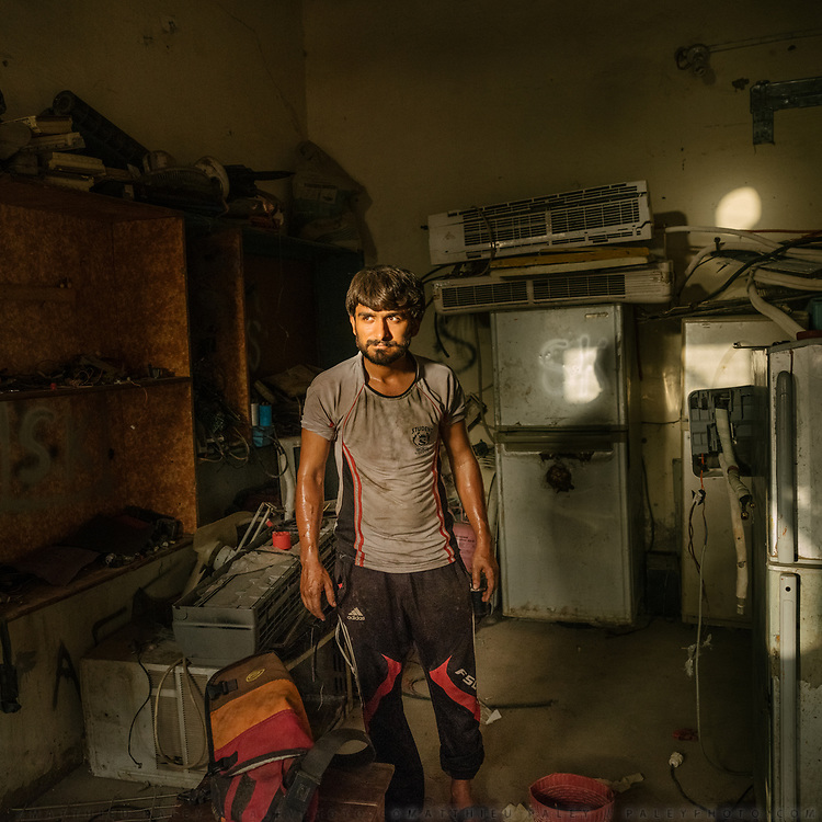 "Khan Lala has a household repair shop on the main road. He says that during heat season, the Air conditioning repair demands increases dramatically ""the heat is too strong for the compressor""."