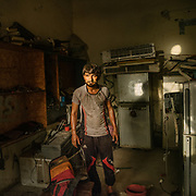 """Khan Lala has a household repair shop on the main road. He says that during heat season, the Air conditioning repair demands increases dramatically """"the heat is too strong for the compressor""""."""