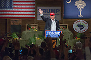 Billionaire and GOP presidential candidate Donald Trump waves after addressing supporters at a rally January 27, 2016 in Lexington, South Carolina.