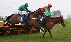 Quel Destin ridden by Sam Twiston-Davies (far side) jumps the last with Adjali ridden by Daryl Jacob on their way to victory in the Coral Finale Juvenile Hurdle during the Coral Welsh Grand National day at Chepstow Racecourse.