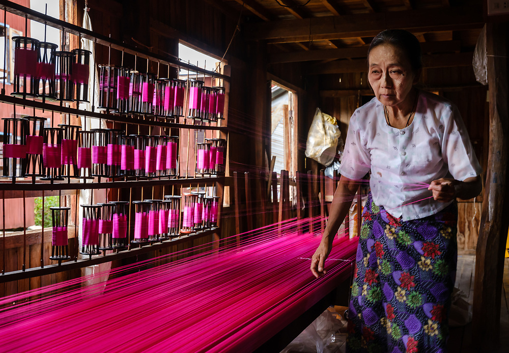 INLE LAKE, MYANMAR - CIRCA DECEMBER 2017: Burmese woman working a the lotus silk weaving handicraft village in Inle Lake
