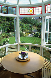 Looking out through the kitchen window to the circular lawn and garden. Window seat and circular table.