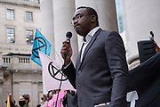 Speakers at the Walk of Shame disruptive mach through the City of London by environmental group Extinction Rebellion on 4th September 2020 in London, United Kingdom. The walk visited various locations in the financial district, to protest against companies and institutions with historical links to the slave trade, or who finance or insure projects which are seen as ecologically unsound. The message by the group is that 'apologies and token attempts at diversity are not enough to address this legacy and present reality. Our demand is reparations and reparatory justice for those affected by colonial and neo-colonial exploitation'. Extinction Rebellion is a climate change group started in 2018 and has gained a huge following of people committed to peaceful protests. These protests are highlighting that the government is not doing enough to avoid catastrophic climate change and to demand the government take radical action to save the planet.