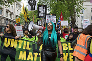 Chantelle Lunt, founder of Merseyside BLM Alliance, marches in front of activists from civil liberties groups taking part in a Kill The Bill National Day of Action in protest against the Police, Crime, Sentencing and Courts PCSC Bill 2021 on 29th May 2021 in London, United Kingdom. The PCSC Bill would grant the police a range of new discretionary powers to shut down protests, including the ability to impose conditions on any protest deemed to be disruptive to the local community, wider stop and search powers and sentences of up to 10 years in prison for damaging memorials.