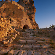 Entrance to Ortahisar Castle at sunset in Cappadocia