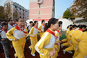 YANGZHOU, CHINA - NOVEMBER 26: (CHINA OUT) <br /> <br /> Students made to Exercise before school<br /> <br /> Over one thousands students of Meiling Middle School run in the morning on their playground on November 26, 2014 in Yangzhou, Jiangsu province of China. Exercising early is beneficial for people both in mental and in physical. Most of schools in China schedule running activity for their students.<br /> ©Exclusivepix