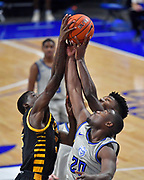 Saint Louis Billikens guard Fred Thatch Jr. (20, right) and Arkansas-Pine Bluff Golden Lions players Markedric Bell (3, left) and Alvin Stredic Jr. (15, back) all grab for a rebound. St. Louis University hosted the University of Arkansas - Pine Bluff in a mens basketball game on December 5, 2020 at Chaifetz Arena on the SLU campus in St. Louis, MO.<br /> Photo by Tim Vizer
