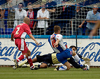 Photo: Jed Wee.<br />Hartlepool United v Swindon Town. Coca Cola League 2.<br />05/08/2006.<br /><br />Swindon goalkeeper Petr Brezovan dives at the feet of Hartlepool's Lee Bullock to preserve their 1-0 lead.