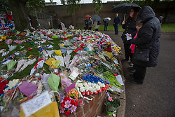 © licensed to London News Pictures. London, UK 29/05/2013. Members of the public paying her respects at the scene where Drummer Lee Rigby was murdered by two men in Woolwich town centre. Photo credit: Tolga Akmen/LNP