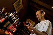 Winemaker and distiller Keith Bodine with samples at Sweetgrass Winery, Union, Maine.