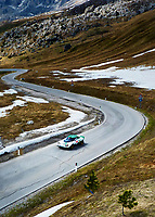 A rare Lancia Stratos rally car is driven over Passo Giao in the Dolomites of the Italian Alps.
