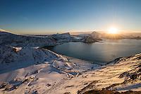 Winter sunset over Haukland beach, Vestvågøy, Lofoten Islands, Norway