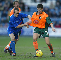 Photo. Aidan Ellis.<br /> Stockport County v Plymouth Argyle.<br /> Nationwide Division 2.<br /> 24/01/2004.<br /> Plymouth's Ian Stonebridge and Stockport's Fraser McLachlan