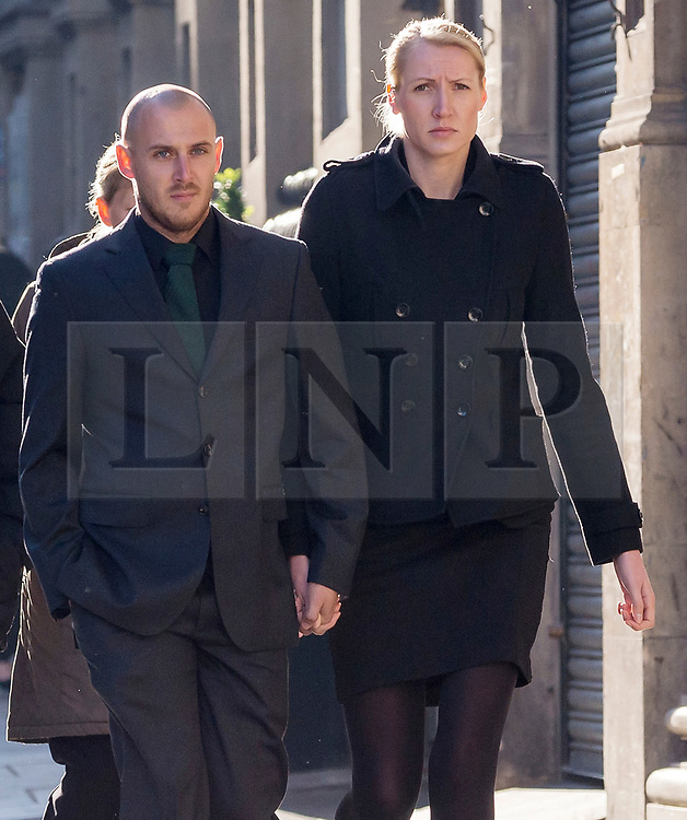 © Licensed to London News Pictures. 09/10/2018. Bristol, UK. Teacher ELLIE WILSON (blonde hair) arrives at Bristol Crown Court on the second day of the second week of her trial, accused of having sexual activity with a school pupil. The jury has now retired to consider the verdict. The 29 year old from Dursley in Gloucestershire denies four counts of abuse of position and sexual activity with a child. She was a physics teacher at a Bristol secondary school (which cannot be named for legal reasons) when the alleged offences took place in August 2015. It is alleged that Wilson had sex with the male pupil in the toilet of an aircraft on the return flight from a school trip to southern Africa. When interviewed Wilson said there was a friendship with the boy and admitted she shouldnít have gone as far as she did but there was nothing sexual. Photo credit: Simon Chapman/LNP