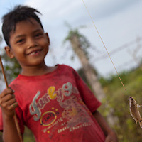 This boy catched a fish in a flooded rice field in Battambang.