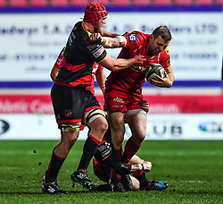 Scarlets' Hadleigh Parkes is tackled by Dragons' Sarel Pretorius and Joseph Davies<br /> <br /> Photographer Craig Thomas/Replay Images<br /> <br /> Guinness PRO14 Round 13 - Scarlets v Dragons - Friday 5th January 2018 - Parc Y Scarlets - Llanelli<br /> <br /> World Copyright © Replay Images . All rights reserved. info@replayimages.co.uk - http://replayimages.co.uk