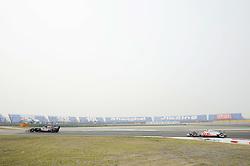 15.04.2011, Shanghai-International-Circuit, Schanghai, CHN, Großer Preis von China / Schanghai 2011, RACE 03 freies Training, im Bild  Jaime Alguersuari (ESP), Scuderia Toro Rosso - Jenson Button (GBR),  McLaren F1 Team     EXPA Pictures © 2011, PhotoCredit: EXPA/ nph/  Dieter Mathis (bitte als Fotovermerk angeben)       ****** only for AUT & SLO ******