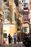 Family group in street scene in Kerkyra, Corfu Town, Greece