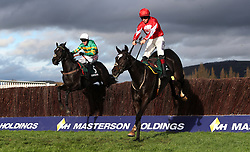 Foxtail Hill ridden by Sam Twiston-davies jumps the last with Le Prezien ridden by Barry Geraghty in the Randox Health Handicap Steeple Chase during day two of the Showcase at Cheltenham Racecourse