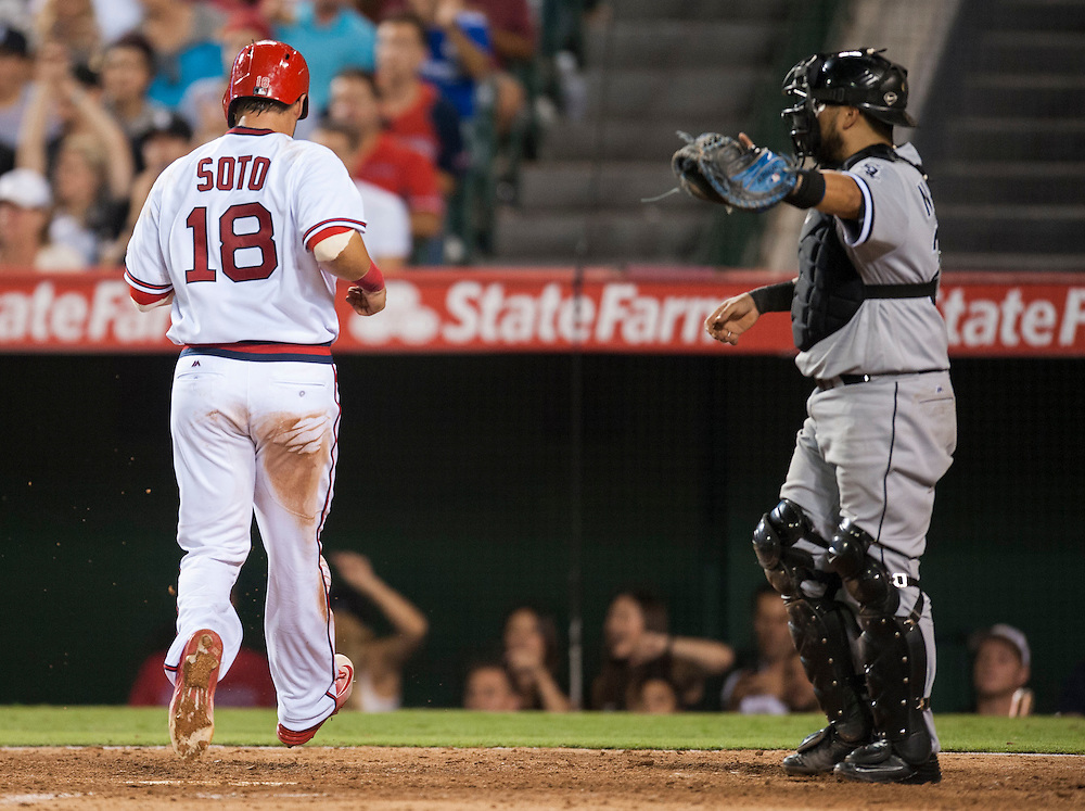 The Angels' Geovany Soto scores past White Sox catcher Dioner Navarro on an error during a five-run seventh inning during the Angels' 7-0 victory over the Chicago White Sox at Angel Stadium on Friday.<br /> <br /> ///ADDITIONAL INFO:   <br /> <br /> angels.0716.kjs  ---  Photo by KEVIN SULLIVAN / Orange County Register  -- 7/15/16<br /> <br /> The Los Angeles Angels take on the Chicago White Sox at Angel Stadium.