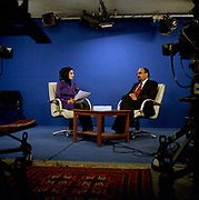 "Mrs Farzana Samimi on her talk show 'Banuî with psychiatrist, Mohammed Yasin Babrak.<br /> <br /> Farzana's show centres on problems faced by Afghan women - largely a taboo subject. Currently, for security reasons guests have to talk by phone: ""I remember one guest - a young girl -  who was forced ( by her parents) to marry."" Says Farzana. ""But because she came on TV, her parents threatened to kill her"".  <br /> <br /> One of Farzana's colleagues was shot dead by unknown gunmen in Kabul in May 2005 and Farzana's  husband wants her to stop presenting but she says:  ""The show is very important. For a lot of women, their only source of help is from the TV.""<br /> A survey of women in Kabul found that 98 percent suffered from post-traumatic stress disorder, chronic depression or severe anxiety. Dr Babrak, Farzana's co presenter says. ""Most women who come to me suffer from mood swings and schizophrenia,"""