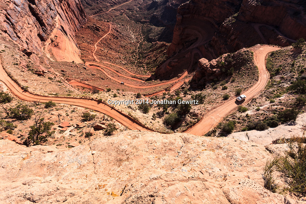 Looking down on a steep part of the Shafer Trail in Canyonlands National Park, Utah. WATERMARKS WILL NOT APPEAR ON PRINTS OR LICENSED IMAGES.<br /> <br /> Licensing: https://tandemstock.com/assets/84554369