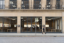 Edinburgh, Scotland, UK. 24 March, 2020.  Closed Apple store on Princes Street. All shops and restaurants are closed with very few people venturing outside following the Government imposed lockdown today.  Iain Masterton/Alamy Live News