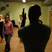 "Choreographer/costume designer/show director Lemington Ridley, foreground, directs dancers Michele Knaub, from left, Simone Assboeck, Meredith Stead and Arlene Yu, during a rehearsal for ""A Show Unlike Anything on Broadway!"" at Stepping Out Studios in Manhattan on April 25, 2007 in preparation for the 5 Boro Dance Challenge...The locally produced 5 Boro Dance Challenge, New York City's first same-sex dance competition, was held at the Park Central Hotel in Manhattan from May 4-6, 2007. ..The show was the entertainment presented in addition to the competition. ..."