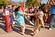 Nov. 22, 2009 -- PHOENIX, AZ: Women from the Phoenix Metro Maharshtra Mandal dance in the street during the annual Discover India Festival in Phoenix, AZ. This is the 8th year the Indian Association of Phoenix has sponsored the festival, which started as a celebration of Diwali, the Indian Festival of Lights, and has since grown to be a celebration of India's cultures, traditions and diversity.    Photo by Jack Kurtz