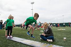 A young boy attempts a long jump during the Bristol Sport festival - Photo mandatory by-line: Dougie Allward/JMP - Mobile: 07966 386802 - 06/06/2015 - SPORT - Multi-Sport - Bristol - SGS Wise Campus - Bristol Sport Festival Of Youth Sport - Festival Of Youth