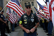 Bill Michell, 61, long time member of the Patriot Guard Riders standing in front of the Bedsford Central Presbyterian church, while awaiting the passage of LCpl. Nicholas J. Whyteís coffin, in Brooklyn, New York, NY., on Friday, June 30, 2006. LCpl. Nicholas J. Whyte, a 21-year-old American serviceman died  on June 21, 2006, while conducting combat operations in Al Anbar province, Iraq. The Patriot Guard Riders is a diverse amalgamation of riders from across the United States of America. Besides a passion for motorcycling, they all have in common an unwavering respect for those who risk their lives for the country's freedom and security. They are an American patriotic group, mainly but not only, composed by veterans from all over the United States. They work in unison, calling upon tens of different motorcycle groups, connected by an internet-based web where each of them can find out where and when a 'Mission' is called upon, and have the chance to take part. This way, the Patriot Guard Riders can cover the whole of the United States without having to ride from town to town but, by organising into different State Groups, each with its own State Captain, they are still able to maintain strictly firm guidelines, and to honour the same basic principles that moves the group from the its inception. The main aim of the Patriot Guard Riders is to attend the funeral services of fallen American servicemen, defined as 'Heroes' by the group,  as invited guests of the family. These so-called 'Missions' they undertake have two basic objectives in particular: to show their sincere respect for the US 'Fallen Heroes', their families, and their communities, and to shield the mourners from interruptions created by any group of protestors. Additionally the Patriot Guard Riders provide support to the veteran community and their families, in collaboration with the other veteran service organizations already working in the field.   **ITALY OUT**