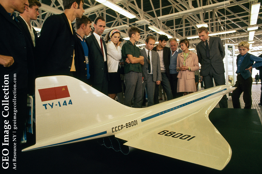 Yugoslavians view a model of the Soviet space transport, Tupolev 144,  a Soviet supersonic passenger airliner designed by Tupolev in operation from 1968 to 1999. The Tu-144 was the world's first commercial supersonic transport aircraft with its prototype's maiden flight from Zhukovsky Airport on 31 December 1968, two months before the British-French Concorde.