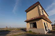 Tsunami damaged buildings in the town of Tomioka, Futaba District of Fukushima, Japan. Monday April 29th 2013. The town was evacuated on March 12th after the March 11th 2011 earthquake and tsunami cause meltdowns at the nearby Fukushima Daichi nuclear power station. It lies well within the 20 kms exclusion zone though parts of the town were opened in spring 2013 again to allow locals to visit their property during daylight hours.