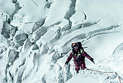 Climber ( Geoff Bartram) ascending fixed rope on 1984 White Limbo route, North face Chomolungma, Tibet side Mt Everest