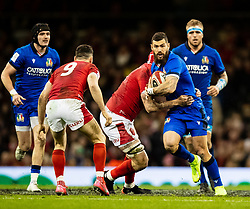 Jayden Hayward of Italy under pressure from Cory Hill of Wales<br /> <br /> Photographer Simon King/Replay Images<br /> <br /> Six Nations Round 1 - Wales v Italy - Saturday 1st February 2020 - Principality Stadium - Cardiff<br /> <br /> World Copyright © Replay Images . All rights reserved. info@replayimages.co.uk - http://replayimages.co.uk