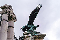 Budapest, Hungary.  Buda Castle with a Turul statue. The Turul is a mythological bird of the Magyars.