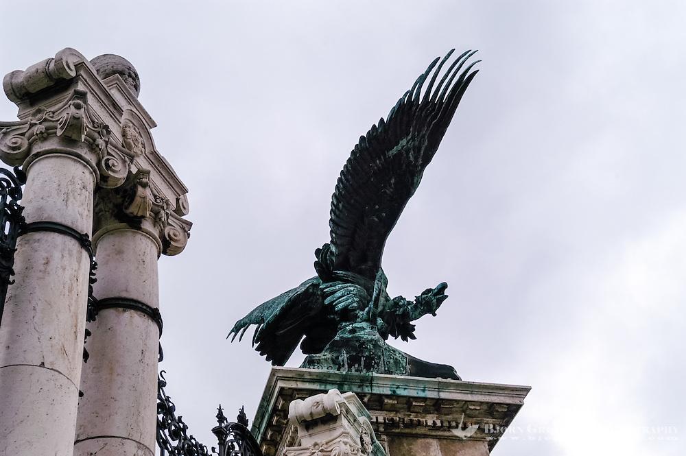 Budapest, Hungary.  Buda Castle with a Turul statue. The Turul is a mythological bird of the Magyars.