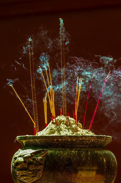 Incense burning, Wat Phnom is a sacred Buddhist pagoda prominently sitting atop a small hill  (at 89 feet it is the highest point in the city) in the Cambodian capital city of Phnom Penh. It was built in 1373.