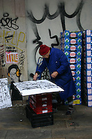 Artist working on drawing at spanish marketplace<br />