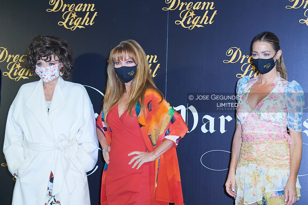 Dame Joan Collins, Jane Seymour, Denise Richards attends 'Glow and Darkness' photocall at Palace Hotel on October 26, 2020 in Madrid, Spain