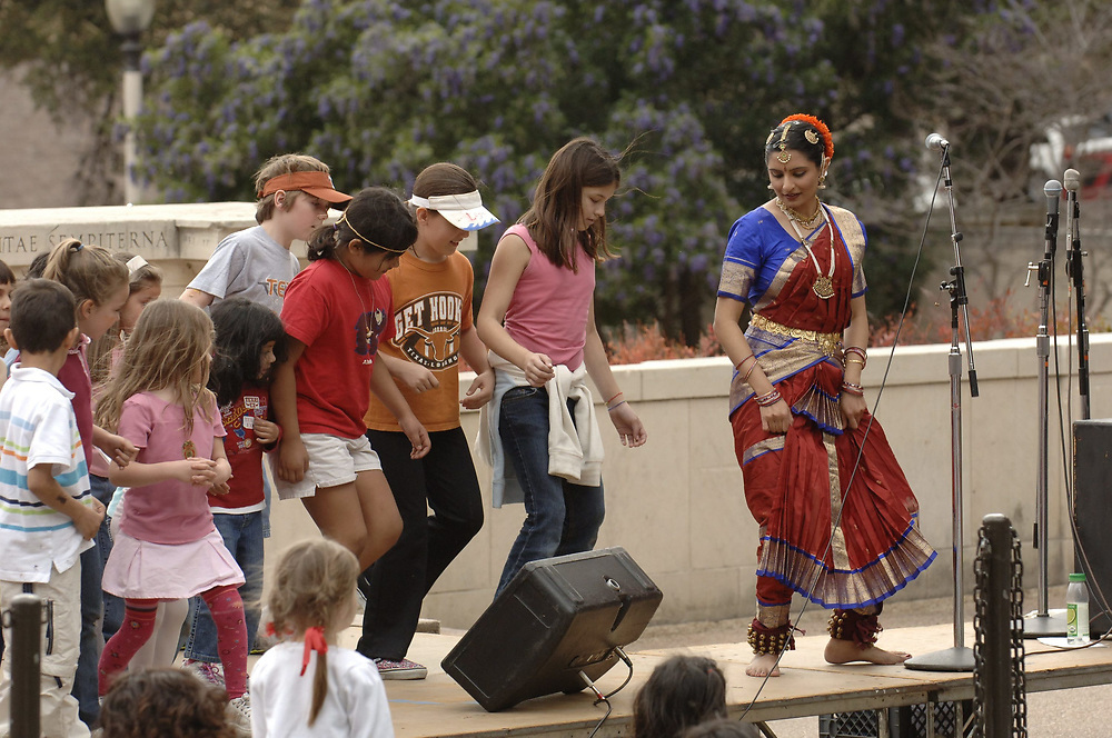 Austin, TX March 4, 2006: Indian dancer Keerti Kirpalani teaches a classical Indian dance called Bharatnatyam to parents, students and visitors on the University of Texas at Austin campus at the Explore UT open house. <br /> ©Bob Daemmrich
