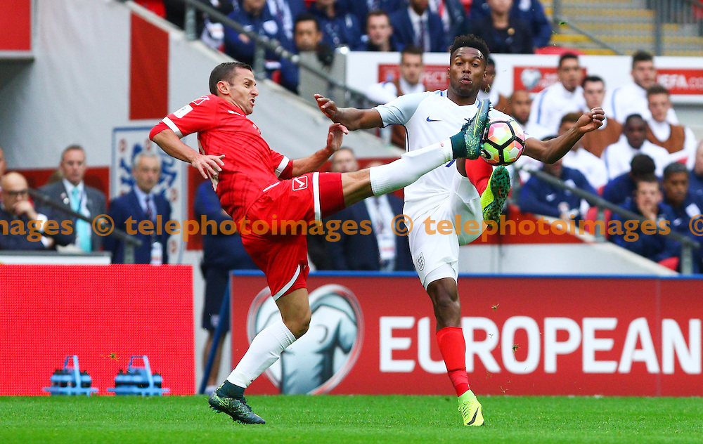 Daniel Sturridge of England (right) battles for the ball during the FIFA World Cup Qualifier match between England and Malta at Wembley Stadium in London. October 8, 2016.<br /> Arron Gent / Telephoto Images<br /> +44 7967 642437