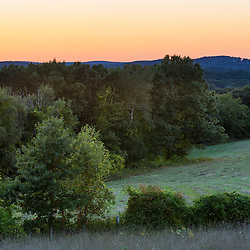 Fields and trees at dusk on Sagamore Hill in Hamilton, Massachusetts.