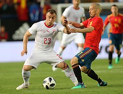 Xherdan Shaqiri of Switzerland, left, here with David Silva of Spain, right during Spain v Switzerland international friendly match in Villareal, Spain, June 3, 2018. The game finished in a 1-1 draw. Photo by Giuliano Bevilacqua/ABACAPRESS.COM