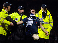 Photo: Jed Wee/Sportsbeat Images.<br /> Scotland v Italy. UEFA European Championships Qualifying. 17/11/2007.<br /> <br /> A pitch invader just after the Scotland goal is apprehended by stewards.