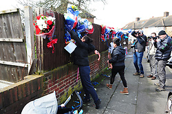 © Licensed to London News Pictures.10/04/2018<br /> HITHER GREEN, UK.<br /> Family and friends of Henry Vincent arrive to hang up the ripped down flowers ..<br />  Hither Green Burglary Murder. South Park Crescent,Hither Green.<br /> Family and friends of Henry Vincent arrive to hang up the ripped down flowers  outside the home of 78 year old Richard Osborn-Brooks who stabbed a burglar to death in his home.<br /> Photo credit: Grant Falvey/LNP