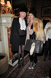 Left to right, LUCINDA COOKE and EMILY LOBEL at a screening of Charlotte Olympia's new film 'To Die For' held at Mark's Club, Charles Street, London W1 on 22nd February 2011.