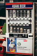 Beer vending machine on the street near a subway station in Tokyo, Japan. Material World Project..